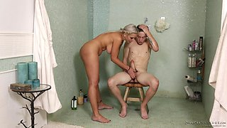 Nina Elle covered in oil while seducing her insatiable lover