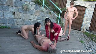 Outdoors fucking between a dirty old couple and a sexy young babe