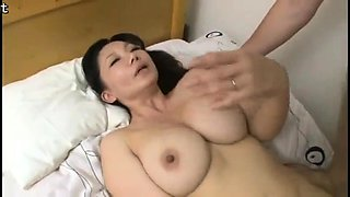 Striking Asian mom with perfect big boobs fucks a young cock