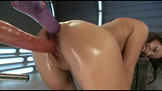 Kinky girl enjoys several huge dildos on a sex machine