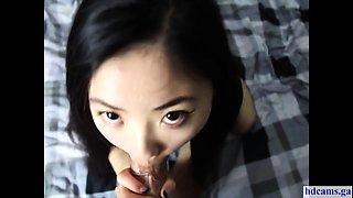 Cute Asian sucks and swallows big load