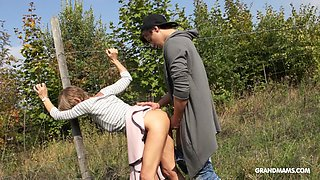 Stuck in the fence mature whore gets banged doggy hard outdoors