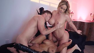 Busty MILF and her dominant mistress share stepson's cock
