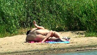 Beach voyeur finds a horny couple enjoying wild sex