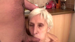 Hairy granny fucks with young guy in the kitchen