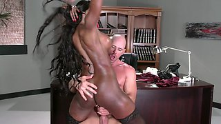 A black woman is getting fucked in the office on the desk