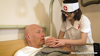 Teen nurse in glasses Adelle Sabelle gives a wonderful blowjob to pensioner