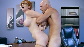 Redhead secretary has her big tits worshiped