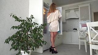 Fridge Humping Chic. Milf in a bathrobe fucks fridge door