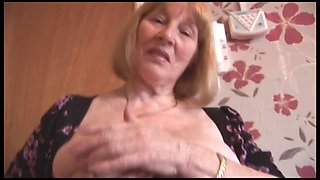 Attractive busty granny and teases then shows off her hairy