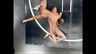 Winner of lesbian wrestling wears strapon