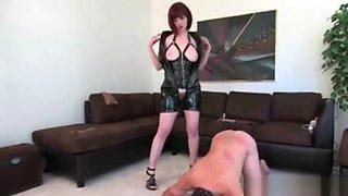 Red head mistress dominates her slave