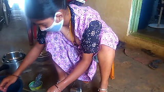 Tamil hot wife showing her big boobs while cleaning home