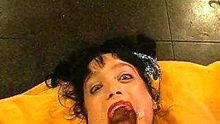 Ugly German whore enjoys a bukkake orgy