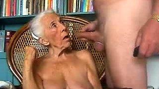 Horny amateur granny with big tits deepthroats a meat pole