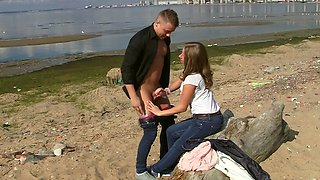 Couple is fucking at the beach outside on a hot and sunny day