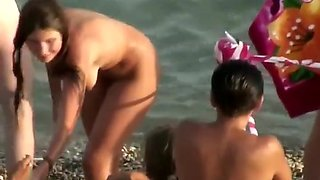 Sexy nudist girl spied in a bigger group