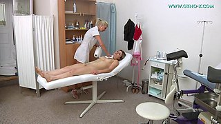female and male gynecologists have fun with blonde sexy patient