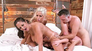 Two women are with two guys and they are making a fun foursome