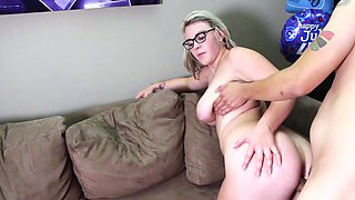 A hot thing with glasses and some really large tits is getting fucked