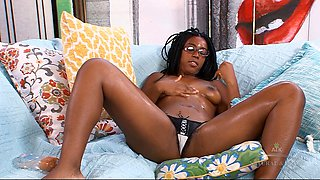 Ebony babe strips down and oils up