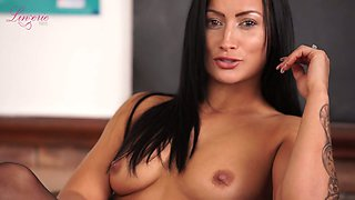 Dressed like college chick Kelli Smith flashes her natural tits and hard nipples