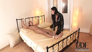Domme In Sexy Latex Sucks Cock
