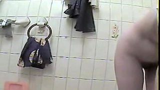 Housewife with hairy cunt caught on cam in wash room
