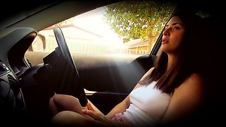 Busty brunette drives her tight pussy to orgasm in the car
