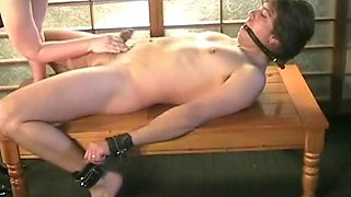 BBW Mature gives submissive slave a slow handjob