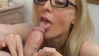 Stimulating blonde granny in glasses Nina Hartley sucking a