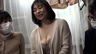 Mature Oriental slut with big hooters enjoys a gang of cocks